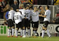 Valencia's players celebrate a goal during their Spanish La Liga match against Betis, on April 22, at the Mestalla stadium in Valencia. Valencia play Malaga next, at Estadio La Rosaleda, on Sunday