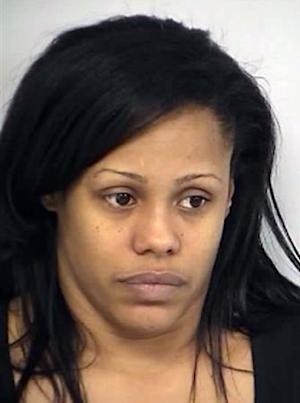 This image provided by the Las Vegas Metropolitan Police Department shows Laketha Moore, who was arrested March 19, 2013 and is being held on 31 felony child abuse and neglect charges, for allegedly tying her 4-year-old daughter to a bed and locking her in a room in an apartment for up to 12 hours a day. (AP Photo/Las Vegas Metropolitan Police Department)