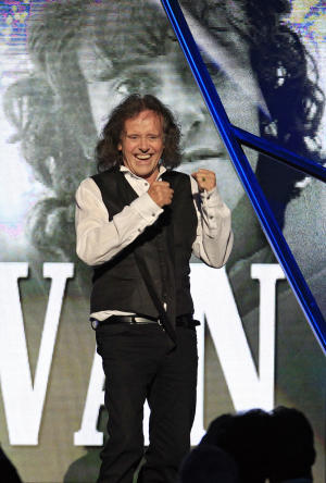 Donovan Leitch reacts after his induction into the Rock and Roll Hall of Fame Saturday, April 14, 2012, in Cleveland. (AP Photo/Tony Dejak)