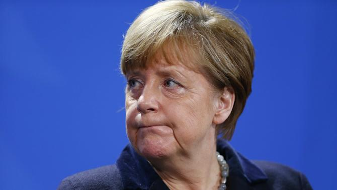 German Chancellor Merkel addresses a news conference at the Chancellery in Berlin, file