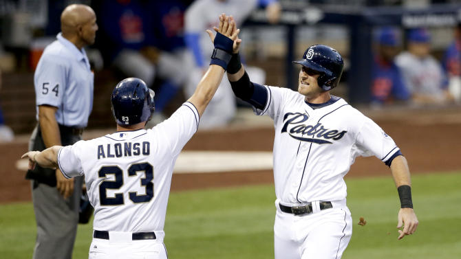San Diego Padres' Will Middlebrooks, right, and teammate Yonder Alonso (23) celebrates after scoring off a two-RBI single by Alexi Amarista against the New York Mets during the second inning of a baseball game Tuesday, June 2, 2015, in San Diego. (AP Photo/Gregory Bull)