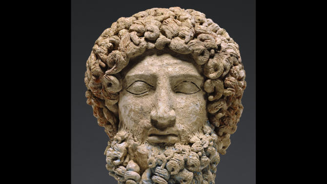 This undated image provided by the J. Paul Getty Museum shows a terracotta head depicting the Greek god Hades. The museum plans to return the head to Sicily after determining it was clandestinely excavated from an archaeological site in the 1970s. The museum took initiative to investigate the pieceís origins after seeing fragments in a publication that could join to the head, which dates to about 400 to 300 B.C., according to Timothy Potts, the museumís director. The Getty procured the piece in 1985. (AP Photo/J. Paul Getty Museum)