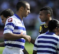 Queens Park Rangers' defender Anton Ferdinand (L) avoids shaking hands with Chelsea's defender Ashley Cole before their English Premier League football match in London