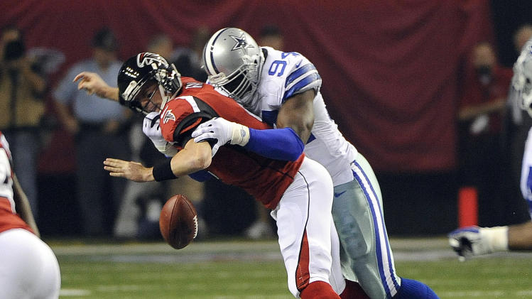 Atlanta Falcons quarterback Matt Ryan (2) looses the football as he is sacked by Dallas Cowboys linebacker DeMarcus Ware (94) during the first half of an NFL football game, Sunday, Nov. 4, 2012, in Atlanta. Atlanta recovered the fumble. (AP Photo/David Tulis)