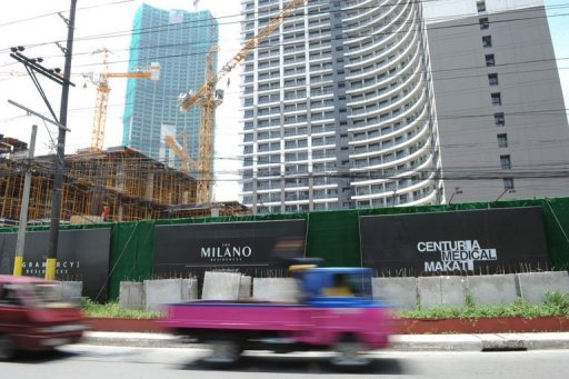<p>Commuters are seen driving past a high-rise building construction site in Manila. As a Philippine property boom gathers pace, even Paris Hilton, Donald Trump and high-fashion house Versace are getting a piece of the action.</p>