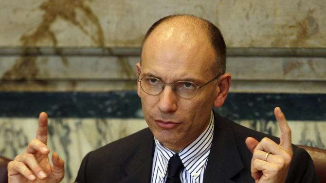 Italian Premier Enrico Letta, delivers his speech at the Economic Survey of Italy forum attended by Angel Gurria, Secretary-General of the Organization for Economic Co-operation and Development (OECD), in Rome, Thursday, May 2, 2013.  (AP Photo/Gregorio Borgia)
