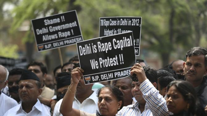 Indian protesters hold placards during a protest to demand for tougher rape laws and better police protection for women, outside the Parliament in New Delhi, India, Monday, April 22, 2013. A second suspect was arrested Monday in the rape of a 5-year-old girl who New Delhi police say was left for dead in a locked room, a case that has brought a new wave of protests against how Indian authorities handle sex crimes. (AP Photo/Manish Swarup)