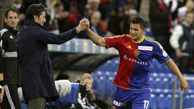 Raul Bobadilla (R) and his coach Murat Yakin of FC Basel (FCB) celebrate after he scored during their Swiss Super League soccer match match against FC St. Gallen in Basel June 1, 2013 (Reuters)