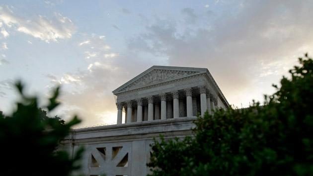 The Supreme Court in Washington, is seen as the sun rises.