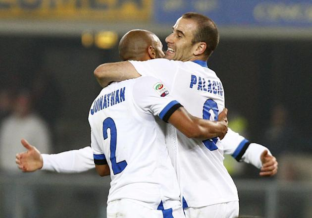 Inter Milan's Jonathan, left, celebrates with teammate Rodrigo Palacio after scoring during a Serie A soccer match against Hellas Verona at the Bentegodi stadium in Verona, Italy, Saturday, March