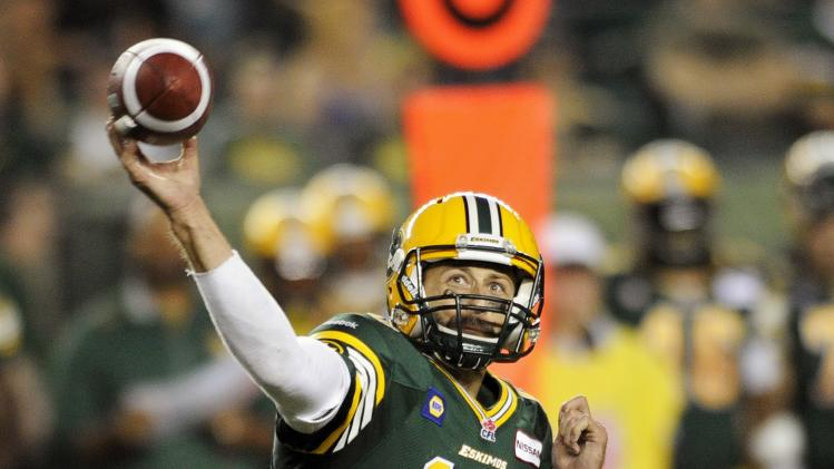 Eskimos' Reilly throws pass against RedBlacks during their CFL football game in Edmonton