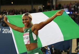 Nigeria's Blessing Okagbare carries her country's flag after winning the women's 200m final  at the 2014 Commonwealth Games in Glasgow