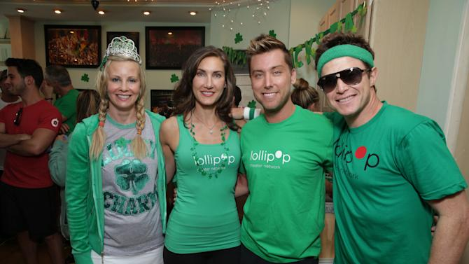 Monica Potter, Lollipop Theater's Evelyn Iocolano, Lance Bass and Billy Bush at St. Patty's Day Slimdown benefiting the Lollipop Theatre Network held at Slimmons on Sunday, Mar., 17, 2013 in Beverly Hills, CA. (Photo by Eric Charbonneau/Invision for Lollipop Theatre Network/AP Images)