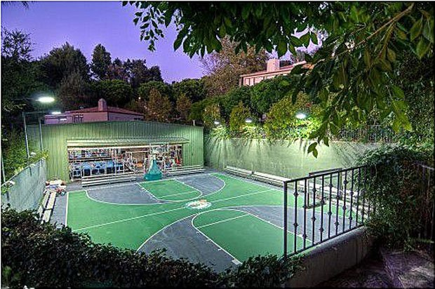Nader Nazemi-The outdoor basketball court can also be used for tennis and racquetball. (Zillow.com)
