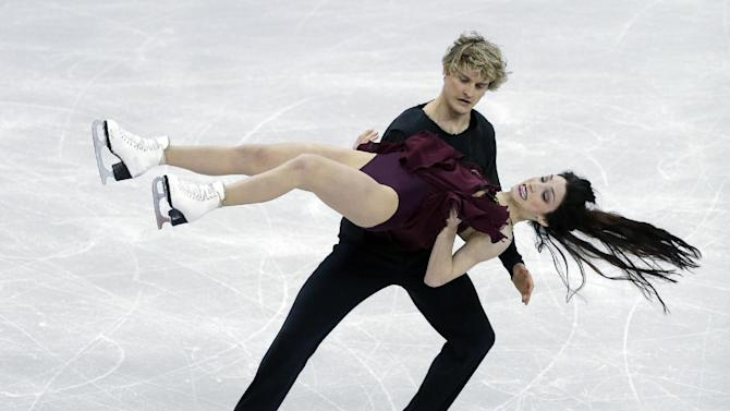 Meryl Davis, front, and Charlie White compete during the senior pairs free dance program at the U.S. figure skating championships on Saturday, Jan. 26, 2013, in Omaha, Neb. (AP Photo/Charlie Neibergall)