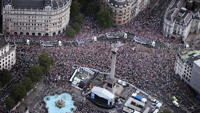 Floats carrying British Olympic and Paralympic athletes take part in a parade as seen from the air as they pass Trafalgar Square, London, Monday, Sept. 10, 2012. Thousands of people waving British flags lined the streets of London on Monday to toast the athletes behind the country's unprecedented summer of sporting success. (AP Photo/Peter Macdiarmid, Pool)