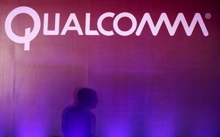 Shadow is cast near Qualcomm logo at the 2015 Computex exhibition in Taipei,