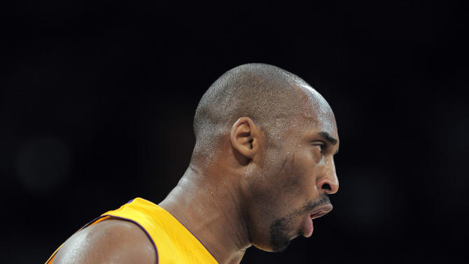 Los Angeles Lakers shooting guard Kobe Bryant reacts after scoring a three-point basket during the first half of their NBA basketball game against the Cleveland Cavaliers, Friday, Jan. 13, 2012, in Los Angeles. (AP Photo/Mark J. Terrill)