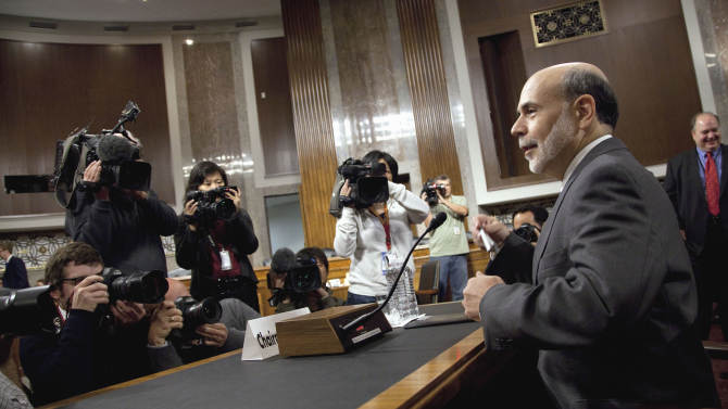 Federal Reserve Board Chairman Ben Bernanke arrives to testify on Capitol Hill in Washington, Tuesday, Oct. 4, 2011, before the Joint Economic Committee hearing on the economic outlook.  (AP Photo/Evan Vucci)