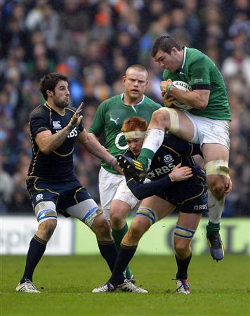 Scotland's Harley tackles Ireland's O'Mahony during their Six Nations rugby match at Murrayfield Stadium in Edinburgh