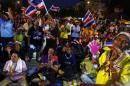 Anti-government protesters dance as they wait for their leader Suthep Thaugsuban to address them from the stage near the Government house in Bangkok