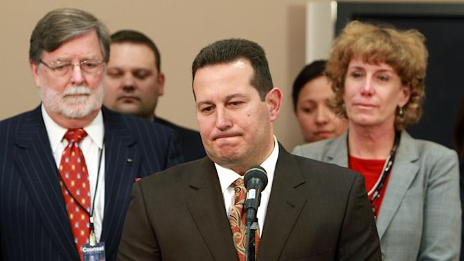 Jose Baez, lead defense counsel for Casey Anthony, pauses while answering questions after his client was found not guilty in her first-degree murder trial, at the Orange County Courthouse, in Orlando, Fla., Tuesday, July 5, 2011.   Looking on are co-counsel Cheney Mason, left, and Dorothy Clay Sims. (AP Photo/Joe Burbank, Pool)