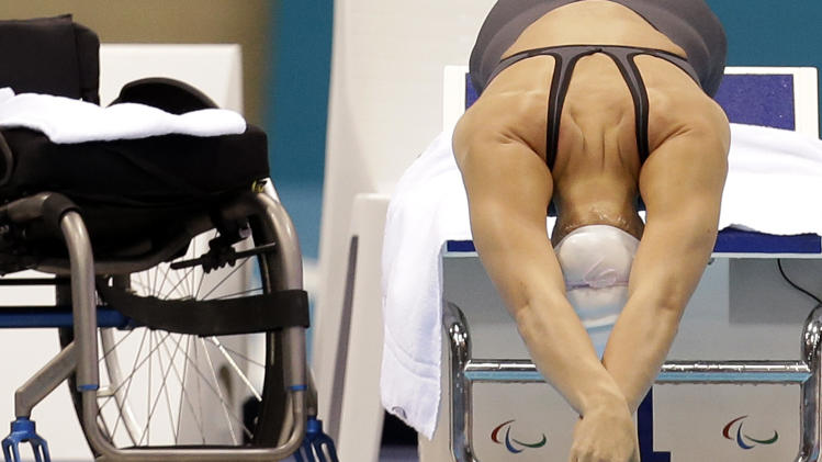 Malloy Weggemann of the United States swims in the women's 100-meter breastroke SB7 heats at the 2012 Paralympics games, Saturday, Sept. 1, 2012, in London. (AP Photo/Alastair Grant)