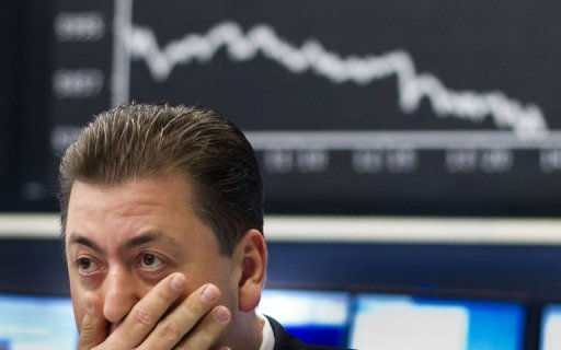 <p>A trader sits in front of screens showing the German DAX index in Frankfurt in 2011. Europe's main stock markets fell heavily on Monday in a poor start to the week as investors reacted to news of sliding business confidence in eurozone economic engine Germany, dealers said.</p>