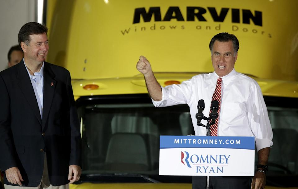 Republican presidential candidate, former Massachusetts Gov. Mitt Romney, accompanied Virginia Republican Senate candidate George Allen, gestures while speaking at a campaign event Integrity Windows in Roanoke, Va., Thursday, Nov. 1, 2012. (AP Photo/David Goldman)
