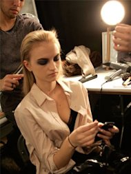 A model prepping for Vera Wang's fall 2011 show during New York Fashion Week