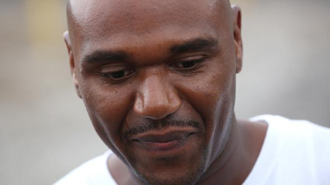 """In this Aug. 31, 2012 photo, Alprentiss Nash, who was been behind bars since his murder conviction in 1995, walks free from the Menard Correctional Center in downstate Chester, Ill., after Cook County prosecutors dropped the case against him. Chicago Police said Wednesday, July 29, 2015, that Nash was fatally shot in Chicago, Tuesday, July 28 after after an argument during """"some sort of transaction"""" between Nash and his attacker. (E. Jason Wambsgans/Chicago Tribune via AP)"""