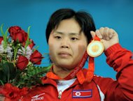 Pak Hyon-Suk of North Korea poses during the awarding ceremony for the women&#39;s 63kg weightlifting event at the 2008 Beijing Olympic Games. When Pak clinched the gold at the games, she heaped praise on Kim Jong-Il, who was known as the &quot;Dear Leader&quot; or &quot;Dear General.&quot;