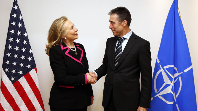 Secretary of State Hillary Rodham Clinton shakes hands with NATO Secretary-General Anders Fogh Rasmussen at the NATO headquarters in Brussels, Tuesday, Dec. 4, 2012.  (AP Photo/Kevin Lamarque, Pool)