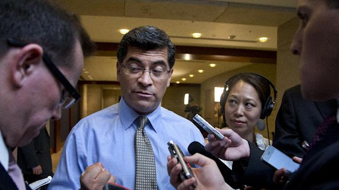 Rep. Xavier Becerra, D-Calif., center, speaks to reporters as he arrives for a closed all-member briefing on the NSA on Capitol Hill in Washington, Tuesday, June 11, 2013.    (AP Photo/Manuel Balce Ceneta)