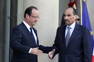 "French President Francois Hollande (L) shakes hands with Mauritanian President Mohamed Ould Abdel Aziz after a meeting at the Elysee Palace in Paris, on November 20. Aziz will return to his country Saturday from France, where he was recovering after being ""accidentally"" shot by a soldier last month, state media reported."