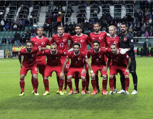 Turkey's team players pose for the media before their 2014 World Cup qualifying soccer match against Estonia in Tallinn