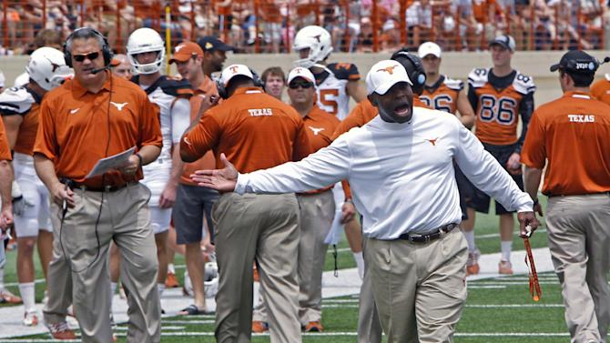 Texas opens camp with dismissals, suspensions