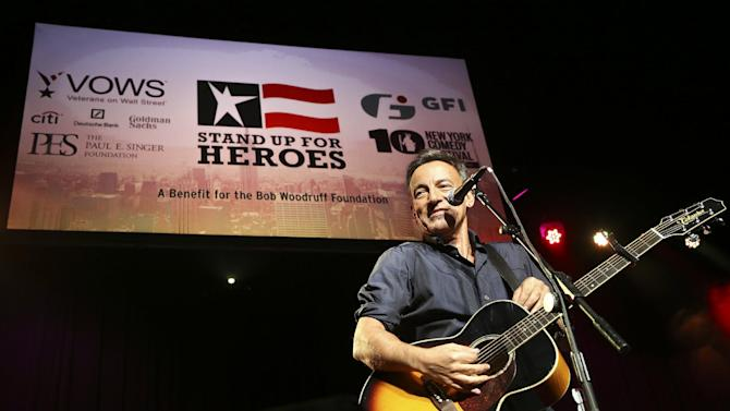 "FILE - In this Nov. 6, 2013 file photo, musician Bruce Springsteen performs at the Stand Up for Heroes event at Madison Square Garden, in New York. Bruce Springsteen, Stevie Nicks, Carrie Underwood, Chris Martin: The stars are turning out to salute the 2014 Rock and Roll Hall of Fame inductees. The hall of fame says Tuesday, April 1, 2014, that ""The Boss"" will fittingly induct and perform with his loyal E Street Band, while a superstar lineup of Nicks, Underwood, Bonnie Raitt, Emmylou Harris and Sheryl Crow will perform for Linda Ronstadt. (John Minchillo/Invision/AP, file)"