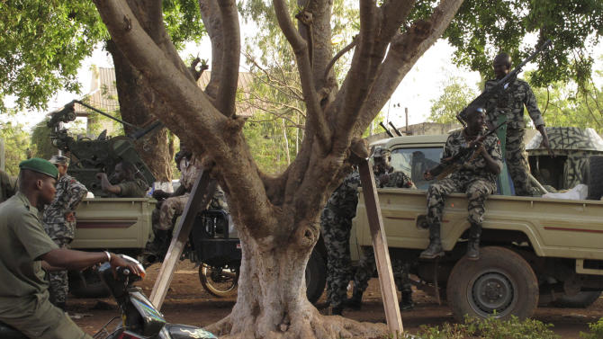 Soldiers stand guard at junta headquarters in Kati, outskirt Bamako, Mali Tuesday, April 3, 2012. With coup leader Capt. Amadou Haya Sanogo refusing to step down, surrounding nations have imposed severe financial sanctions on Mali, including the closing of the country's borders and the freezing of its account at the regional central bank. (AP Photo/Rukmini Callimachi)