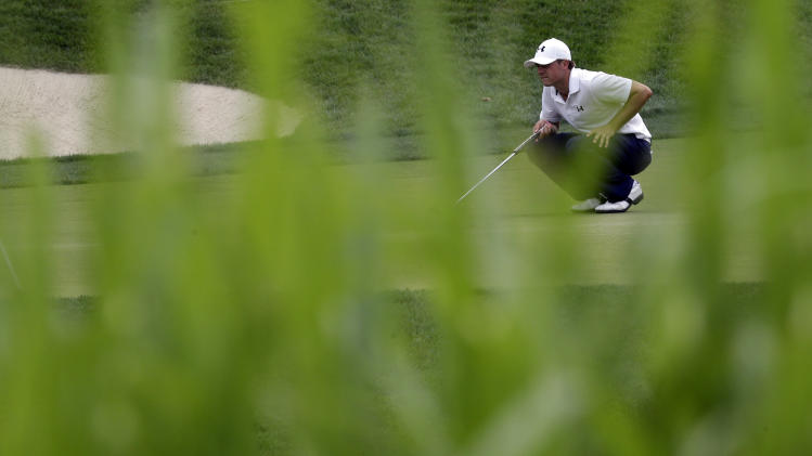 Jordan Spieth inspects his putt on the 11th green during the second round of the AT&T National golf tournament at Congressional Country Club, Friday, June 28, 2013, in Bethesda, Md. (AP Photo/Patrick Semansky)