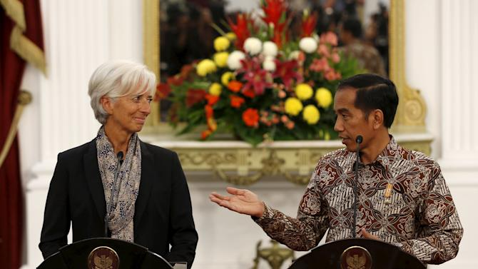 Indonesia President Widodo gestures while addressing the media following his meeting with IMF Managing Director Lagarde at the presidential palace in Jakarta