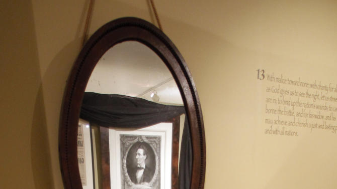 This Monday, Nov. 19, 2012 photo shows a stove pipe hat and mirror used by Abraham Lincoln is seen at the Robert Todd Lincoln mansion Hildene in Manchester, Vt.  The Georgian Revival home was built in 1905 by Robert Todd Lincoln, the only one of the president's four children to survive to adulthood. (AP Photo/Toby Talbot)