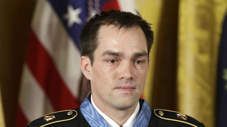 Medal of Honor recipient, retired Staff Sgt. Clinton Romesha is seen on stage during the ceremony in the East Room of the White House in Washington, Monday, Feb. 11, 2013, where President Barack Obama bestowed the medal. Romesha's leadership during a daylong attack by hundreds of fighters on Combat Outpost Keating in Afghanistan led to award. (AP Photo/Pablo Martinez Monsivais)