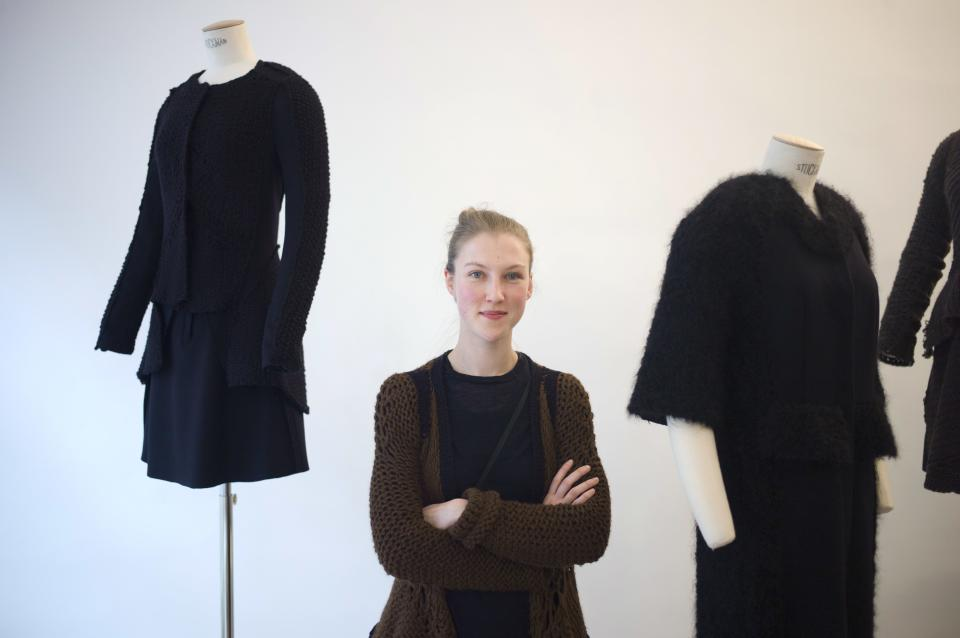 French fashion designer Alice Lemoine poses among her creations as part of the presentation of Le Moine Tricote's ready-to-wear Fall/Winter 2013-2014 collection, presented in Paris, Tuesday, Feb. 26, 2013. (AP Photo/Thibault Camus)