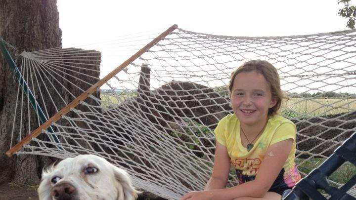 CAPTION CORRECTION, CORRECTS CITY TO EDMOND This July 2014 photo provided by Dr. Danel Grimmett, shows Willow Grimmett, 10, with her agility dog, Emmy, at their home in Edmond, Okla. Willow spent the summer outdoors with the family's English Setter, designing and running obstacle courses. For millions of dogs across the country, summer is gone and so are their best buddies. Most dogs object for a while but eventually adjust to the new hours. But millions of others will feel abandoned, panicky, sad and unable to cope as they look for ways to lash out. (AP Photo/Danel Grimmett)