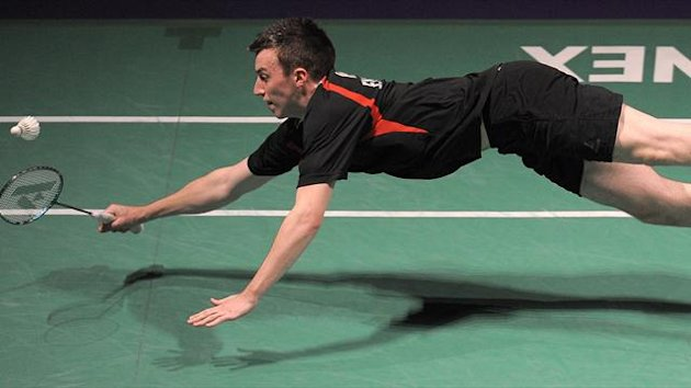 Peter Mills of England dives for a shot during his Quarter final mens double&#39;s match against Kindervater and Fuchs of Germany during the European Badminton Championships in Manchester (AFP)