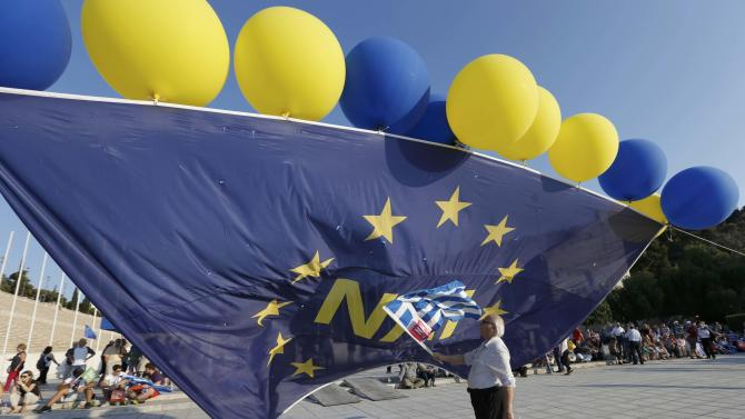 A 'Yes' supporter arrives for the upcoming pro-Euro rally at the Panathenean stadium in Athens