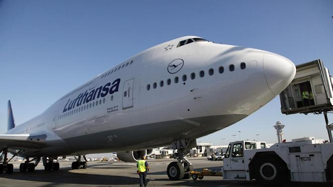 FILE - In this Monday, Dec. 10, 2012, file photo, Lufthansa's Boeing 747-8 Brandenburg aircraft arrives at Los Angeles International Airport, after its inaugural passenger flight from Frankfurt, Germany to Los Angeles. For decades, the Boeing's 747 was the Queen of the Skies. But the glamorous double-decker jumbo jet that revolutionized air travel and shrunk the globe could be nearing the end of the line. (AP Photo/Nick Ut, File)