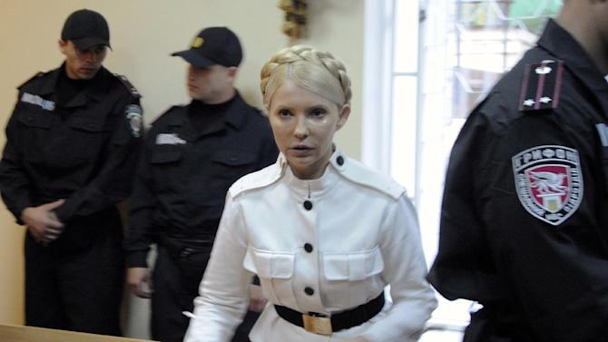 FILE - Former Ukrainian Prime Minister Yulia Tymoshenko during a trial hearing at the Pecherskiy District Court in Kiev, Ukraine, in this file photo dated Wednesday, June 29, 2011.  Europe's human rights court in Strasbourg, France, ruled Tuesday April 30, 2013, that Ukraine's jailing of former Prime Minister Yulia Tymoshenko was a politically motivated violation of her rights, but it is unclear if the European court ruling would be legally binding in Ukraine. (AP Photo/Sergei Chuzavkov, File)