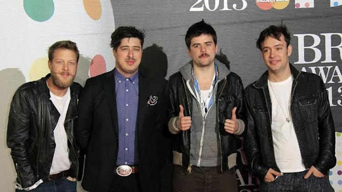 From left, Ted Dwane, Marcus Mumford, Country Winston, and Ben Lovett of British band Mumford and Sons seen arriving at the BRIT Awards 2013 at the o2 Arena in London on Wednesday, Feb. 20, 2013. (Photo by Joel Ryan/Invision/AP)